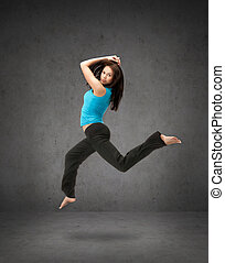 beautiful sporty woman jumping in sportswear