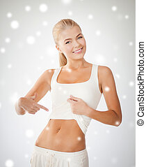 beautiful sporty woman pointing at abs - picture of...