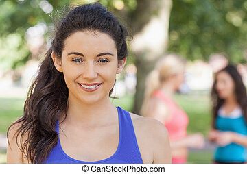 Beautiful sporty woman posing in a park