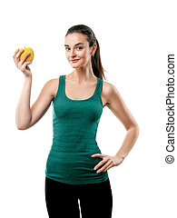beautiful sporty woman with apple