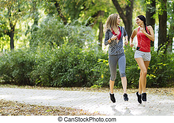 Beautiful sporty women jogging