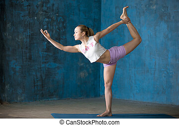 Beautiful sporty young woman Doing Natarajasana