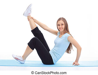 sporty young woman doing stretching exercise of the muscles .