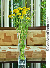 Beautiful spring flowers in vase on the table