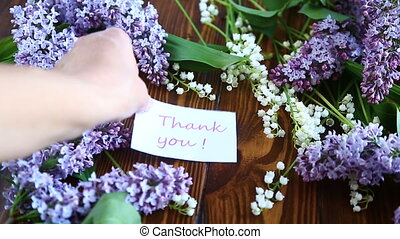 Beautiful spring flowers lily of the valley and lilac flowers