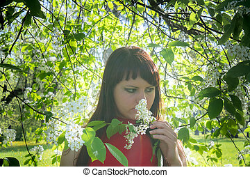 Beautiful Spring Girl with flowers.