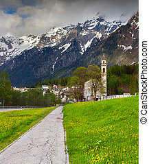 Beautiful spring landscape with church in the Swiss Alps.