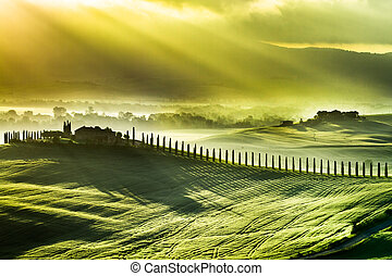 Beautiful spring sunrise over the valley of San Quirico...