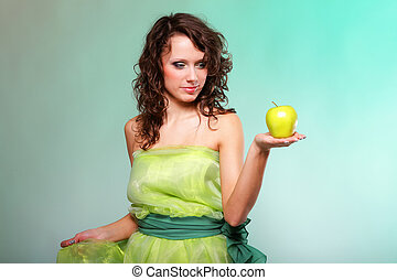 Beautiful spring woman with apple. Green concept
