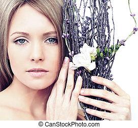 Beautiful spring woman with makeup