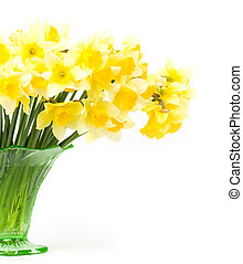 yellow flowers in a glass vase