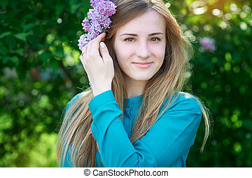 beautiful spring young woman in a park