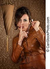 Beautiful Spy with Binoculars in Leather Coat