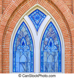 Beautiful stained glass window of a brick building