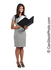 Beautiful standing african american businesswoman reading a report