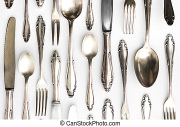 beautiful sterling cutlery set on white background -...