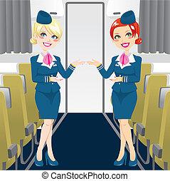 Beautiful Stewardess - Two beautiful stewardess in blue...