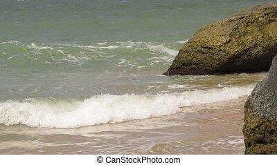 Beautiful stones in the waves on ocean coast. sea, waves crashing against the rocks