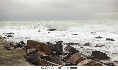 Beautiful stones on a wave background slow mo