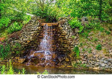 beautiful streaming waterfall with a river, tropical garden architecture, nature background