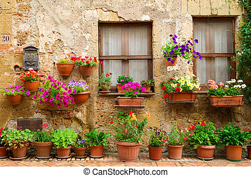 Beautiful street decorated with flowers in Italy