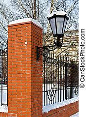 Beautiful street lamp at the red-brick wall