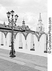 street lamp on an ancient stone bridge black and white
