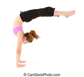 Beautiful strong child in a handstand with legs held out. Clipping path over white.