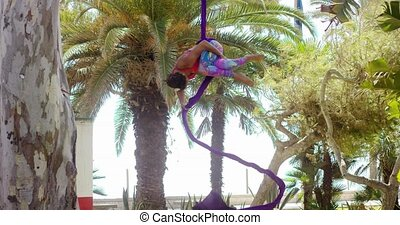 Beautiful strong young gymnast doing an acrobatic dance...