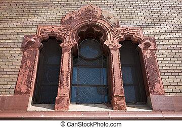 Beautiful stucco molding window on the facade of the church