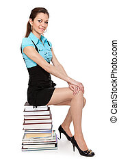 Beautiful student is sitting on the book
