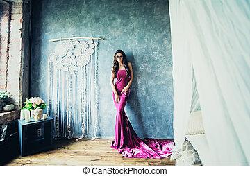 Beautiful Stylish Fashion Model Woman in Lilac Dress Posing in Boho Chic Style Interior
