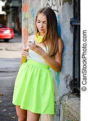 Beautiful stylish fashion woman calling on mobile