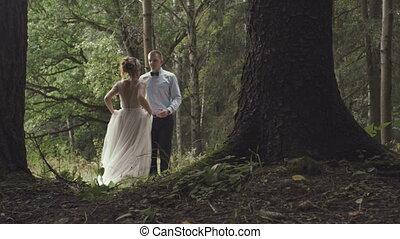stylish groom holding fabulous happy bride