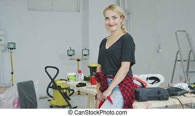 Beautiful stylish woman standing at workbench - Gorgeous...