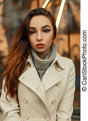 157f5dd6d39a0 Beautiful stylish young brunette girl in trendy coat posing outdoors