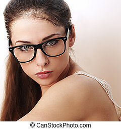 Beautiful successful woman in black eyeglasses looking sexy. Closeup
