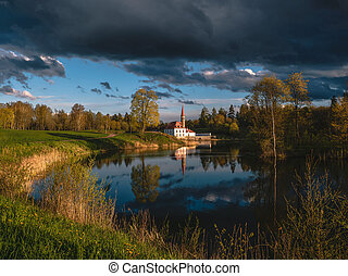 Beautiful summer cloudy landscape with a Priory Palace in Gatchina. Russia