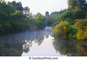 summer landscape with sunrise by the river and fog