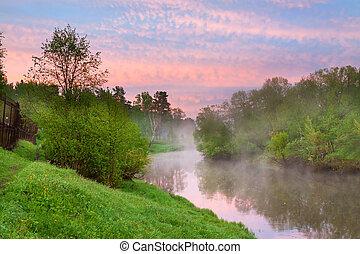 summer rural landscape with river, forest and fog at sunrise