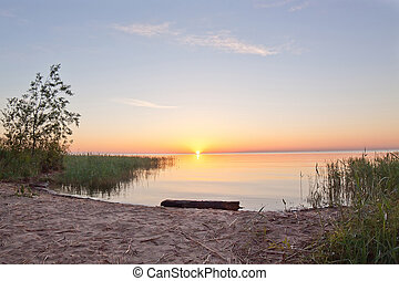 Beautiful summer sunrise on Ladoga lake, Russia