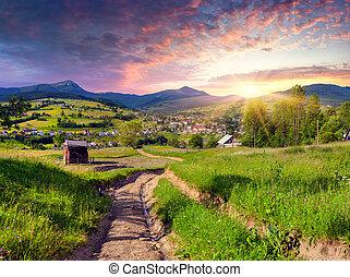 Beautiful summer sunset in the mountain village