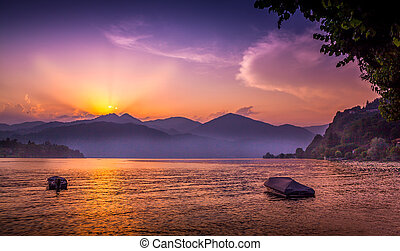 Beautiful summer sunset on the Orta lake, Italy