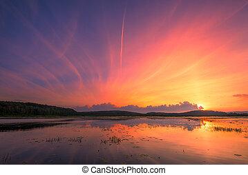 Beautiful summer sunset over the lake