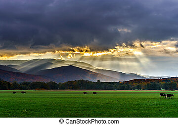Beautiful sun rays through the clouds over mountains
