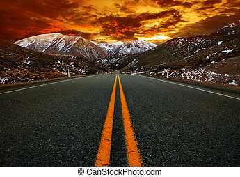 beautiful sun rising sky with asphalt highways road against snow mountain scenery background in ne zealand