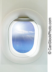 beautiful sun shining over clear blue ocean through  frame of wi