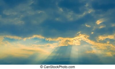 Beautiful Sunbeams Through Moving Clouds