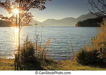 beautiful sundown on a lake in bavaria