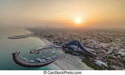Beautiful Sunrise. Aerial View of Jumeirah Beach from Burj Al Arab, Dubai, UAE timelapse